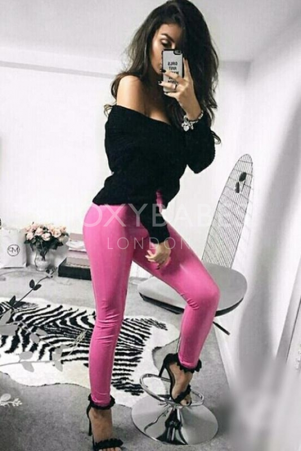 sexy girl with pink trousers and black top