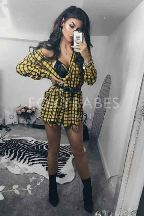 sexy escort in yellow chequered dress